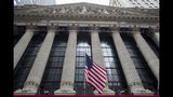 FILE - In this Nov. 20, 2018 file photo, a U.S. flag flies outside New York Stock Exchange. Stocks fell in early trading on Wall Street Thursday, Nov. 21, 2019, as investors worry that the U.S. and China will fail to make a trade deal before the year is over. (AP Photo/Mary Altaffer, File )