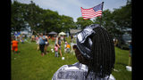 FILE - In this July 4, 2019, file photo, Malu Klo, an asylum seeker from the Congo, attends a picnic for refugees at Fort Williams Park in Cape Elizabeth, Maine. Three agencies in charge of resettling refugees in the U.S. are suing the Trump administration over the president's executive order allowing states and cities to block refugees from being settled in their areas. The lawsuit was filed Thursday, Nov. 21, 2019, by HIAS, Church World Service, and Lutheran Immigration and Refugee Services in U.S. District Court in Baltimore. (AP Photo/Robert F. Bukaty, File)