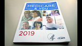 FILE - In this Nov. 8, 2018 file photo, the U.S. Medicare Handbook is photographed in Washington. Medicare's new prescription drug plan finder has a glitch that can steer unwitting seniors to coverage that costs much more than they need to pay. (AP Photo/Pablo Martinez Monsivais)