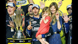 FILE - In this Nov. 17, 2013, file photo, Jimmie Johnson, center, his wife, Chandra, and his daughter, Genevieve, celebrate after he won his sixth NASCAR Sprint Cup Series championship, in Homestead, Fla. Jimmie Johnson is the latest NASCAR superstar to climb out of his car, with the seven-time champion announcing Wednesday, Nov. 20, 2019, that 2020 will be his final season of full-time racing. (AP Photo/Terry Renna, File)
