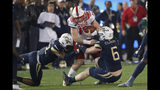 North Carolina State quarterback Devin Leary (13) is stopped by Georgia Tech linebackers David Curry (6) and Jordan Domineck (42) after a short gain during the first half of an NCAA college football game Thursday, Nov. 21, 2019, in Atlanta. (AP Photo/John Bazemore)