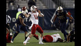 North Carolina State quarterback Devin Leary (13) throws from the pocket against Georgia Tech during the first half of an NCAA college football game Thursday, Nov. 21, 2019, in Atlanta. (AP Photo/John Bazemore)