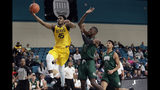 Baylor guard Davion Mitchell (45) drives to the basket against Ohio forward Nate Springs (2) and forward Ben Roderick (3) during the first half of an NCAA college basketball game at the Myrtle Beach Invitational in Conway, S.C., Thursday, Nov. 21, 2019. (AP Photo/Gerry Broome)