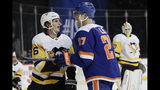 Pittsburgh Penguins' John Marino (6) and New York Islanders' Anders Lee (27) exchange words during the second period of an NHL hockey game Thursday, Nov. 21, 2019, in New York. (AP Photo/Frank Franklin II)