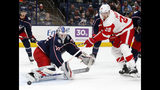 Columbus Blue Jackets goalie Joonas Korpisalo, front left, of Finland, stops a shot by Detroit Red Wings forward Anthony Mantha during the first period of an NHL hockey game in Columbus, Ohio, Thursday, Nov. 21, 2019. (AP Photo/Paul Vernon)