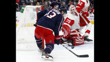 Columbus Blue Jackets forward Cam Atkinson, left, settles the puck in front of Detroit Red Wings goalie Jimmy Howard during the second period of an NHL hockey game in Columbus, Ohio, Thursday, Nov. 21, 2019. Atkinson scored on the play. (AP Photo/Paul Vernon)