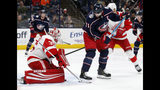 Detroit Red Wings goalie Jimmy Howard, left, stops a shot behind Columbus Blue Jackets forward Nick Foligno during the second period of an NHL hockey game in Columbus, Ohio, Thursday, Nov. 21, 2019. (AP Photo/Paul Vernon)