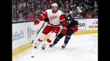 Detroit Red Wings forward Anthony Mantha, left, passes the puck in front of Columbus Blue Jackets defenseman Vladislav Gavrikov, of Russia, during the first period of an NHL hockey game in Columbus, Ohio, Thursday, Nov. 21, 2019. (AP Photo/Paul Vernon)