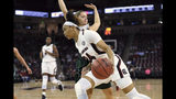 South Carolina's LeLe Grissett (24) drives along the baseline while defended by South Carolina-Upstate's Anda Kuzmina during the first half of an NCAA college basketball game Thursday, Nov. 21, 2019, in Columbia, S.C. (AP Photo/Richard Shiro)