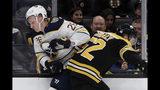 Buffalo Sabres defenseman Rasmus Dahlin (26) and Boston Bruins center Sean Kuraly (52) crash along the boards during the first period of an NHL hockey game Thursday, Nov. 21, 2019, in Boston. (AP Photo/Elise Amendola)