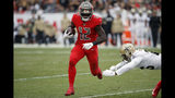Tampa Bay Buccaneers wide receiver Chris Godwin (12) misses a tackle by New Orleans Saints cornerback P.J. Williams (26) on a 30-yard touchdown reception during the second half of an NFL football game Sunday, Nov. 17, 2019, in Tampa, Fla. (AP Photo/Mark LoMoglio)