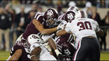 Texas A&M quarterback Kellen Mond, left, reaches the ball across the goal line to score a touchdown against South Carolina during the second half of an NCAA college football game Saturday, Nov. 16, 2019, in College Station, Texas. (AP Photo/David J. Phillip)