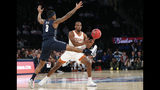 Texas guard Matt Coleman III (2) passes as Georgetown guard James Akinjo (3) defends him during the first half of the first round of the 2K Empire Classic NCAA college basketball tournament, Thursday, Nov. 21, 2019, in New York. (AP Photo/Kathy Willens)