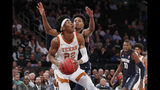 Georgetown forward Jamorko Pickett (1) defends Texas forward Kai Jones (22) during the first round of the 2K Empire Classic NCAA college basketball tournament, Thursday, Nov. 21, 2019, in New York. (AP Photo/Kathy Willens)