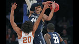 Georgetown center Omer Yurtseven (44) loses the ball as Texas forward Jericho Sims (20) defends him with Georgetown forward Josh LeBlanc (23) looking on during the first half of the first round of the 2K Empire Classic NCAA college basketball tournament, Thursday, Nov. 21, 2019, in New York. (AP Photo/Kathy Willens)