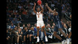 Georgetown forward Galen Alexander (11) defends Texas guard Matt Coleman III (2) who shoots a three-pointer during the first round of the 2K Empire Classic NCAA college basketball tournament, Thursday, Nov. 21, 2019, in New York. (AP Photo/Kathy Willens)