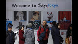 """Tourists stand in front of a """"Welcome to Tokyo"""" sign while waiting in line to visit the Tokyo Metropolitan Government building's observation deck Thursday, Nov. 21, 2019, in Tokyo. The French language has been almost invisible during the drawn-out preparations for next year's Tokyo Olympics. (AP Photo/Jae C. Hong)"""