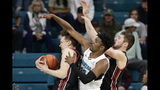 Utah forward Mikael Jantunen, left, forward Riley Battin right, struggle for the ball with Coastal Carolina forward Tommy Burton (33) during the first half of an NCAA college basketball game at the Myrtle Beach Invitational in Conway, S.C., Thursday, Nov. 21, 2019. (AP Photo/Gerry Broome)