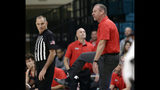 Utah head coach Larry Krystkowiak, right, argues with an official during the first half of an NCAA college basketball game magainst Coastal Carolina at the Myrtle Beach Invitational in Conway, S.C., Thursday, Nov. 21, 2019. (AP Photo/Gerry Broome)