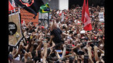 "Former Brazilian President Luiz Inacio Lula da Silva is carried by supporters through a jubilant crowd during a rally at the Metal Workers Union headquarters, in Sao Bernardo do Campo, Brazil, Saturday, Nov. 9, 2019. Da Silva addressed thousands of supporters a day after being released from prison. ""During 580 days, I prepared myself spiritually, prepared myself to not have hatred, to not have thirst for revenge,"" the former president said. (AP Photo/Nelson Antoine)"