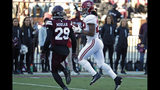 Alabama running back Najee Harris (22) evades Mississippi State safety C.J. Morgan (29) on his way to a 19-yard touchdown pass reception during the first half of an NCAA college football game in Starkville, Miss., Saturday, Nov. 16, 2019. Alabama won 38-7. (AP Photo/Rogelio V. Solis)