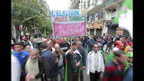 """Algerian demonstrators take to the streets in the capital Algiers to protest against the government and reject the upcoming presidential elections, in Algeria, Friday, Nov. 22, 2019. The demonstrators in Algiers Friday demanded an end to Algeria's post-colonial political system, including the departure of acting leader Abdelkader Bensalah and powerful army chief Gen. Ahmed Gaid Salah. Banner in French """"The elections are a foregone conclusion."""" And """"People are the leaders."""" (AP Photo/Fateh Guidoum)"""