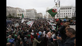 Algerian demonstrators take to the streets in the capital Algiers to protest against the government and reject the upcoming presidential elections, in Algeria, Friday, Nov. 22, 2019. The demonstrators in Algiers Friday demanded an end to Algeria's post-colonial political system, including the departure of acting leader Abdelkader Bensalah and powerful army chief Gen. Ahmed Gaid Salah. (AP Photo/Toufik Doudou)
