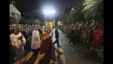 """Pope Francis walks on a street and greets people after Mass with young people at the Assumption Cathedral in Bangkok, Thailand, Friday, Nov. 22, 2019. Pope Francis ministered to Thailand's tiny Catholic community Friday, urging Thais young and old to practice their faith with joy and with """"a Thai face and flesh"""" in an overwhelmingly Buddhist country. (AP Photo/Manish Swarup)"""
