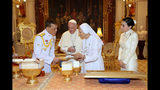 In this photo released by The Royal Household Bureau, Thai King Maha Vajiralongkorn talk to Pope Francis, his cousin Ana Rosa Sivori, and Thai Queen Suthida at Dusit Palace Thursday, Nov. 21, 2019, in Bangkok, Thailand.(The Royal Household Bureau via AP)