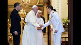 In this photo released by The Royal Household Bureau, Pope Francis and his cousin Ana Rosa Sivori, second right, shake hands with Thai King Maha Vajiralongkorn at Dusit Palace Thursday, Nov. 21, 2019, in Bangkok, Thailand. (The Royal Household Bureau via AP)