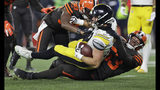 FILE - In this Nov. 14, 2019, file photo, Pittsburgh Steelers tight end Vance McDonald (89) is tackled by Cleveland Browns middle linebacker Joe Schobert (53) during the first half of an NFL football game, in Cleveland. While Myles Garrett serves his indefinite NFL suspension for hitting Pittsburgh quarterback Mason Rudolph over the head with a swung helmet, the Cleveland Browns have to find someone to hold down the star defensive end's spot. (AP Photo/Ron Schwane, File)