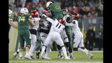 South Florida running back Jordan Cronkrite is tackled by Cincinnati during the first half of an NCAA college football game, Saturday, Nov. 16, 2019, in Tampa, Fla. (AP Photo/Mike Carlson)