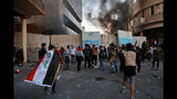 Protesters gather during clashes between Iraqi security forces and anti-Government protesters in Baghdad, Iraq, Thursday, Nov. 21, 2019. Iraqi officials said several protesters were killed as heavy clashes erupt in central Baghdad. (AP Photo/Khalid Mohammed)