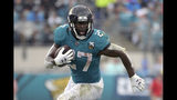 "FILE - In this Oct. 27, 2019, file photo, Jacksonville Jaguars running back Leonard Fournette (27) rushes for yardage against the New York Jets during the first half of an NFL football game, in Jacksonville, Fla. Fournette had a series of meetings and calls this week after carrying the ball a season-low eight times in a 20-point loss to Indianapolis. The most notable of them was chatting with 1981 Heisman Trophy winner and retired Oakland Raiders star Marcus Allen, who told the third-year pro about his experience having to play fullback and share a backfield with fellow Heisman winner Bo Jackson more than 30 years ago. ""His situation was harder than mine,"" said Fournette, who first met Allen during a recruiting visit to USC while he was in high school.(AP Photo/Phelan M. Ebenhack, File)"
