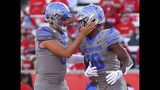 Memphis wide receiver Damonte Coxie, right, celebrates his touchdown with quarterback Brady White during the first half of an NCAA college football game against Houston, Saturday, Nov. 16, 2019, in Houston. (AP Photo/Eric Christian Smith)