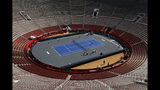 Workers add thefinishing touches at the Plaza de Toros bullfighting ring that has been converted into a tennis court to host an exhibition tennis match between Swiss great Roger Federer and German rival Alexander Zverev, in Mexico City, Friday, Nov. 22, 2019. (AP Photo/Rebecca Blackwell)