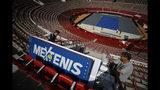 "Workers install a sign promoting ""Mextenis"" at the Plaza de Toros Mexico arena that is being altered to host an upcoming exhibition tennis match between Roger Federer and Alexander Zverev, in Mexico City, Thursday, Nov. 21, 2019. Raúl Zurutuza, the director of Mextenis, which organizes the Acapulco and Los Cabos tennis tourneys, said ""this is an achievement, because we know that it would be hard to get Roger back here as an active player."" (AP Photo/Rebecca Blackwell)"