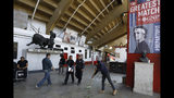 """Workers prepare the Plaza de Toros Mexico bullfighting arena ahead of an upcoming exhibition tennis match dubbed """"The Greatest Match,"""" between Roger Federer and Alexander Zverev, in Mexico City, Friday, Nov. 22, 2019. The event is part of a Latin American exhibition tour that includes Chile, Colombia, Argentina, and concluding in Quito on Sunday. (AP Photo/Rebecca Blackwell)"""