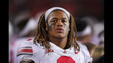 FILE - In this Oct. 18, 2019, file photo, Ohio State defensive end Chase Young looks at the scoreboard during the second half of an NCAA college football game against Northwestern, in Evanston, Ill. Ohio State said, Wednesday, Nov. 13, 2019, the NCAA has concluded that star DE Chase Young must sit out one more football game before he can return.(AP Photo/Charles Rex Arbogast, File)