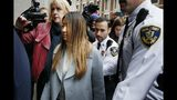 """Inyoung You arrives at Suffolk Superior Court in Boston, Friday, Nov. 22, 2019. Prosecutors say You sent her boyfriend Alexander Urtula more than 47,000 text messages in the last two months of their relationship, including many urging him to """"go kill yourself."""" (AP Photo/Michael Dwyer)"""