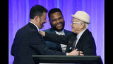 """Honoree Norman Lear, right, is congratulated by presenters Jimmy Kimmel, left, and Anthony Anderson onstage at """"The Paley Honors: A Special Tribute to Television's Comedy Legends"""" at the Beverly Wilshire Hotel, Thursday, Nov. 21, 2019, in Beverly Hills, Calif. (Photo by Chris Pizzello/Invision/AP)"""