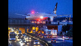 FILE - In this Friday, Sept. 20, 2019 an aircraft crosses a bridge over a highway the airport in Frankfurt, Germany. Inger Andersen, head of the U.N. Environment Program, says the world needs 'quick wins to reduce emissions as much as possible in 2020.' Ahead of a global climate summit in Madrid next week, her agency published a report Tuesday showing the amount of planet-heating gases released into the atmosphere hitting a new high last year. (AP Photo/Michael Probst, File)
