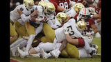 Stanford's Cameron Scarlett, right, is stopped near the goal line by Notre Dame defense including Khalid Kareem (53) in the first half of an NCAA college football game Saturday, Nov. 30, 2019, in Stanford, Calif. (AP Photo/Ben Margot)
