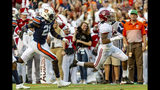 Alabama wide receiver Jaylen Waddle (17) runs past Auburn defensive back Smoke Monday (21) for a touchdown reception during the first half of an NCAA college football game, Saturday, Nov. 30, 2019, in Auburn, Ala. (AP Photo/Vasha Hunt)