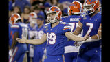 Florida place kicker Evan McPherson (19) celebrates after kicking a 50-yard field goal against Florida State during the first half of an NCAA college football game Saturday, Nov. 30, 2019, in Gainesville, Fla. (AP Photo/John Raoux)