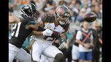 Jacksonville Jaguars cornerback A.J. Bouye (21) breaks up a pass intended for Tampa Bay Buccaneers wide receiver Mike Evans (13) during the first half of an NFL football game, Sunday, Dec. 1, 2019, in Jacksonville, Fla. (AP Photo/Phelan M. Ebenhack)