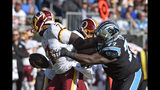 Carolina Panthers defensive tackle Kyle Love (77) rushes Washington Redskins quarterback Dwayne Haskins (7) during the first half of an NFL football game in Charlotte, N.C., Sunday, Dec. 1, 2019. (AP Photo/Mike McCarn)