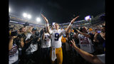 LSU quarterback Joe Burrow (9) gestures thanks to the student section after playing his last game in Tiger Stadium, an NCAA college football game against Texas A&M in Baton Rouge, La., Saturday, Nov. 30, 2019. LSU won 50-7. (AP Photo/Gerald Herbert)