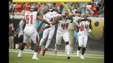 Tampa Bay Buccaneers linebacker Devin White (45) celebrates with teammates including linebacker Kevin Minter (51), free safety Jordan Whitehead, second from left, and outside linebacker Lavonte David (54) after scoring a touchdown on a Jacksonville Jaguars fumble during the first half of an NFL football game, Sunday, Dec. 1, 2019, in Jacksonville, Fla. (AP Photo/Phelan M. Ebenhack)