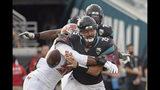 Tampa Bay Buccaneers linebacker Sam Acho, left, forces a fumble as he sacks Jacksonville Jaguars quarterback Gardner Minshew (15) during the second half of an NFL football game, Sunday, Dec. 1, 2019, in Jacksonville, Fla. (AP Photo/Phelan M. Ebenhack)